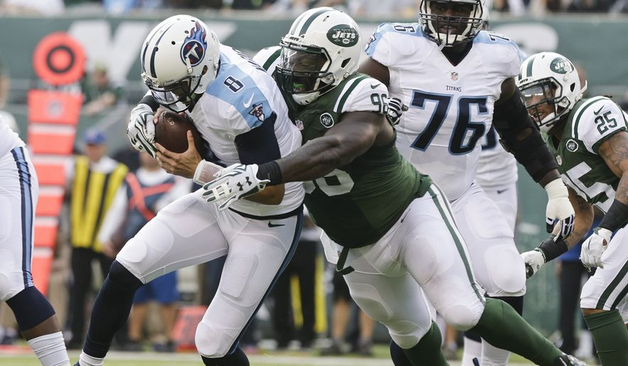 FILE - In this Dec. 13, 2015, file photo, New York Jets defensive end Muhammad Wilkerson (96) sacks Tennessee Titans quarterback Marcus Mariota (8) during the first half of an NFL football game, in East Rutherford, N.J. The Jets have released defensive end Muhammad Wilkerson, ending the one-time Pro Bowl selection's stint with the team that drafted him in the first round in 2011. The team made the long-anticipated move on Wednesday, Feb. 28, 2018, clearing $11 million in salary cap space. (AP Photo/Peter Morgan, File) **FILE**
