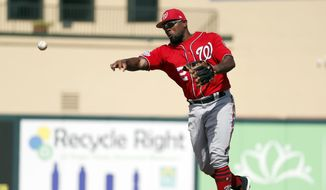 Washington Nationals second baseman Howie Kendrick throws to first during the third inning of an exhibition spring training baseball game against the Marlins Wednesday, Feb. 28, 2018, in Jupiter, Fla. (AP Photo/Jeff Roberson)