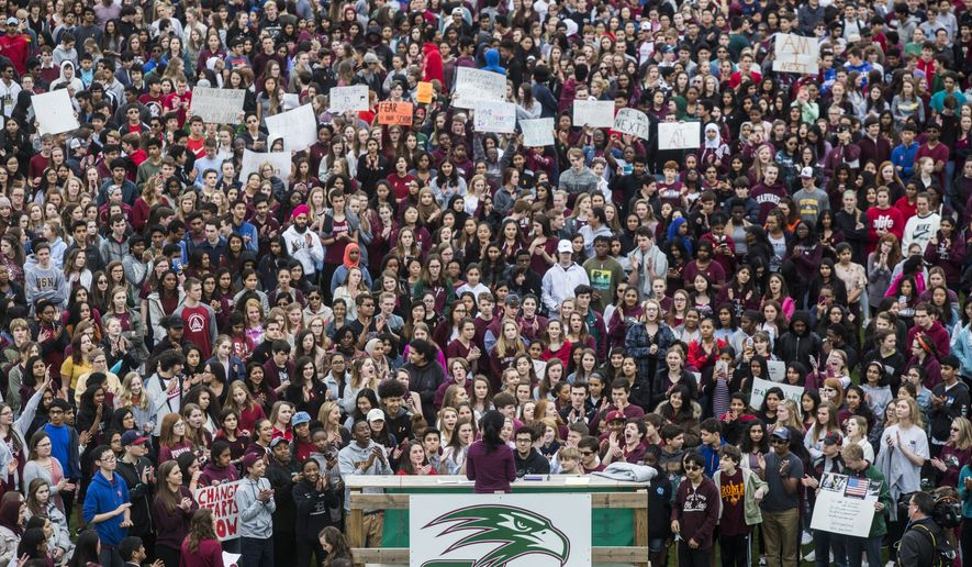 More than 2,000 students walked out of Green Hope High School in Cary, N.C. on Wednesday, Feb. 28, 2018 calling for political change to try to end school gun violence following the recent school shooting in Parkland, Florida.  (Travis Long/The News & Observer via AP)