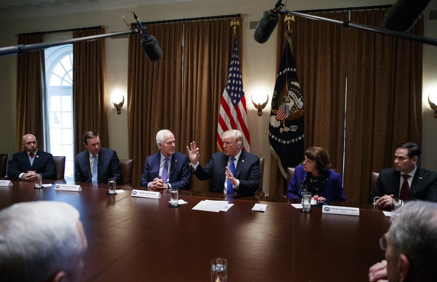 President Donald Trump speaks in the Cabinet Room of the White House, in Washington, Wednesday, Feb. 28, 2018, during a meeting with members of congress to discuss school and community safety. With the president from left, Rep. Brian Mast, R-Fla., Sen. Chris Murphy, D-Conn., Sen. John Cornyn, R-Texas, the president, Sen. Dianne Feinstein, D-Calif., and Sen. Marco Rubio, R-Fla.. (AP Photo/Carolyn Kaster)