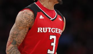 Rutgers guard Corey Sanders reacts during the first half of the team's NCAA college basketball game against Minnesota in the first round of the Big Ten men's tournament Wednesday, Feb. 28, 2018, in New York. (AP Photo/Kathy Willens)