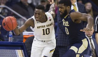 Notre Dame's T.J. Gibbs (10) drives downcourt next to Pittsburgh's Jared Wilson-Frame (0) during the second half of an NCAA college basketball game Wednesday, Feb. 28, 2018, in South Bend, Ind. (AP Photo/Robert Franklin)