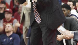 Auburn coach Bruce Pearl reacts to a call against Arkansas during the second half of an NCAA college basketball game Tuesday, Feb. 27, 2018, in Fayetteville, Ark. (AP Photo/Michael Woods)