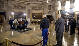 Military members practice placing a casket in the Rotunda of the Capitol, Tuesday, Feb. 27, 2018, in Washington, for the late Rev. Billy Graham to lie in honor tomorrow. President Trump, congressional leaders and the Graham family will be in attendance. (AP Photo/Andrew Harnik)