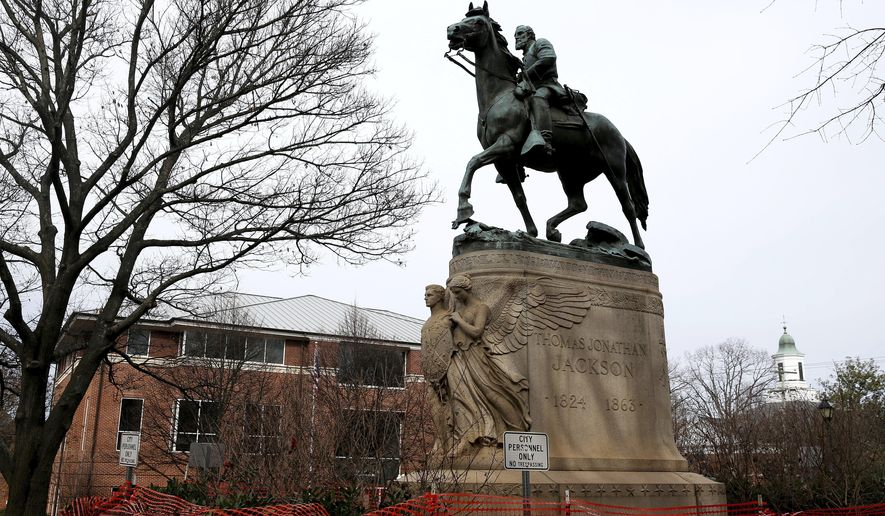 The statue of Robert E. Lee is seen uncovered in Emancipation Park in Charlottesville, Va., on Wednesday, Feb. 28, 2018. (Zack Wajsgras/The Daily Progress via AP)