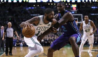 Boston Celtics guard Kyrie Irving, left, drives to the basket against Charlotte Hornets forward Marvin Williams (2) during the first quarter of an NBA basketball game in Boston, Wednesday, Feb. 28, 2018. (AP Photo/Charles Krupa)