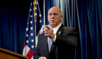 """File - In this Dec. 5, 2017 file photo, then Acting Director for U.S. Immigration and Customs Enforcement Thomas Homan takes a question from a reporter at a Department of Homeland Security news conference in Washington. A federal immigration official says about 800 people living in Northern California were able to avoid arrest because of a warning by Oakland Mayor Libby Schaaf. Homan, the Immigration and Customs Enforcement chief, told """"Fox and Friends"""" Wednesday, Feb. 28, 2018, that what Schaaf did was """"no better than a gang lookout yelling 'police' when a police cruiser comes in the neighborhood."""" (AP Photo/Andrew Harnik, File) **FILE**"""