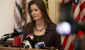 Oakland Mayor Libby Schaaf takes questions from the media during a press conference at City Hall in Oakland, Calif., Wednesday, Feb. 27, 2018. A top immigration official said Wednesday that about 800 people living illegally in Northern California were able to avoid arrest because of a weekend warning that Oakland Mayor Libby Schaaf put on Twitter. (Jane Tyska/San Jose Mercury News via AP)