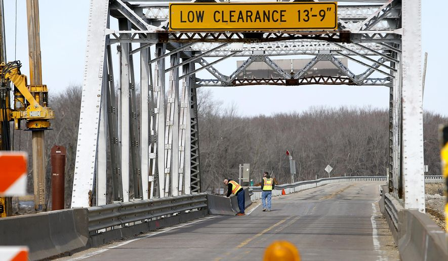 Settlement issues have prompted the closure of this bridge just outside of Sabula, Iowa Tuesday, Feb. 27, 2018. With its closure, travelers cannot access the bridge that spans the Mississippi River and connects with Savanna, Ill.  (Dave Kettering/Telegraph Herald via AP)