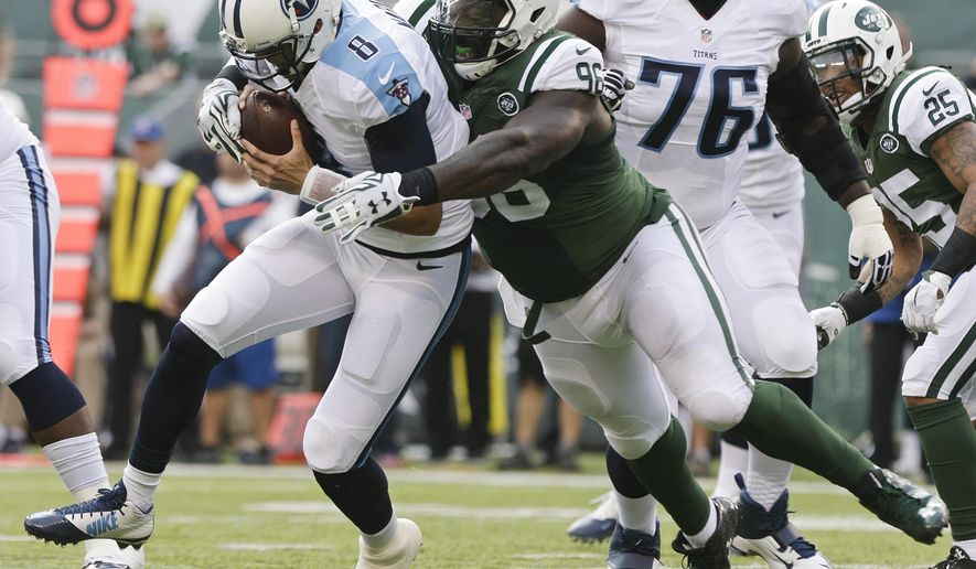 FILE - In this Dec. 13, 2015, file photo, New York Jets defensive end Muhammad Wilkerson (96) sacks Tennessee Titans quarterback Marcus Mariota (8) during the first half of an NFL football game, in East Rutherford, N.J. The Jets have released defensive end Muhammad Wilkerson, ending the one-time Pro Bowl selection's stint with the team that drafted him in the first round in 2011. The team made the long-anticipated move on Wednesday, Feb. 28, 2018, clearing $11 million in salary cap space. (AP Photo/Peter Morgan, File)