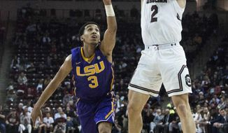 South Carolina guard Hassani Gravett (2) shoots as LSU guard Tremont Waters (3) defends during an NCAA college basketball game Wednesday, Feb. 28, 2018, in Columbia, S.C. (Gavin McIntyre/The State via AP)