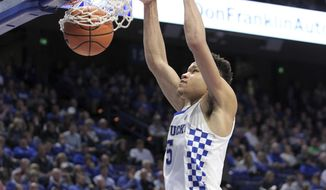 Kentucky's Kevin Knox dunks during the second half of the team's NCAA college basketball game against Mississippi, Wednesday, Feb. 28, 2018, in Lexington, Ky. Kentucky won 96-78. (AP Photo/James Crisp)