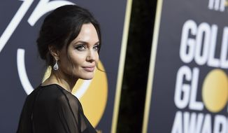 In this Jan. 7, 2018, file photo, Angelina Jolie wears Forevermark Diamond earrings at the 75th annual Golden Globe Awards in Beverly Hills, Calif. (Photo by Jordan Strauss/Invision/AP, File)