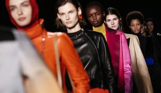 Models wear creations for Lanvin's ready-to-wear fall/winter 2018/2019 fashion collection presented in Paris, Wednesday, Feb. 28, 2018. (AP Photo/Kamil Zihnioglu)