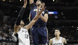 New Orleans Pelicans forward Anthony Davis (23) shoots over San Antonio Spurs forward LaMarcus Aldridge (12) during the first half of an NBA basketball game Wednesday, Feb. 28, 2018, in San Antonio. (AP Photo/Eric Gay)
