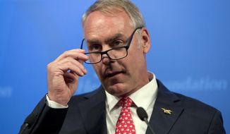 FILE - In this Sept. 29, 2017 file photo Interior Secretary Ryan Zinke speaks on the Trump Administration's energy policy at the Heritage Foundation in Washington. Zinke wants to move more Interior Department employees out of Washington and into the field, closer to the public lands and resources they manage, saying that will lead to improved, decentralized decision-making. More than 90 percent of the department's employees already work outside the Washington area, and some retired department employees say the agency already has a well-established decentralized decision-making process. (AP Photo/Andrew Harnik,File)