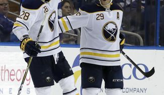 Buffalo Sabres right wing Jason Pominville (29) celebrates his game-winning goal against the Tampa Bay Lightning with center Zemgus Girgensons (28) during overtime in an NHL hockey game Wednesday, Feb. 28, 2018, in Tampa, Fla. Buffalo won 2-1. (AP Photo/Chris O'Meara)