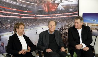 Hollywood producer Jerry Bruckheimer, billionaire David Bonderman, and Oak View Group Chief Executive Tim Leiweke, from left, take part in a TV interview Wednesday, Feb. 28, 2018, in Seattle. The group trying to bring NHL hockey to Seattle says it hopes to hear in June whether its application for an expansion team succeeds, and is launching a season-ticket deposit drive Thursday meant to prove fan interest in a hockey franchise. (AP Photo/Ted S. Warren)