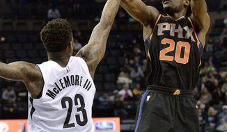 Phoenix Suns forward Josh Jackson (20) shoots against Memphis Grizzlies guard Ben McLemore (23) in the second half of an NBA basketball game Wednesday, Feb. 28, 2018, in Memphis, Tenn. (AP Photo/Brandon Dill)