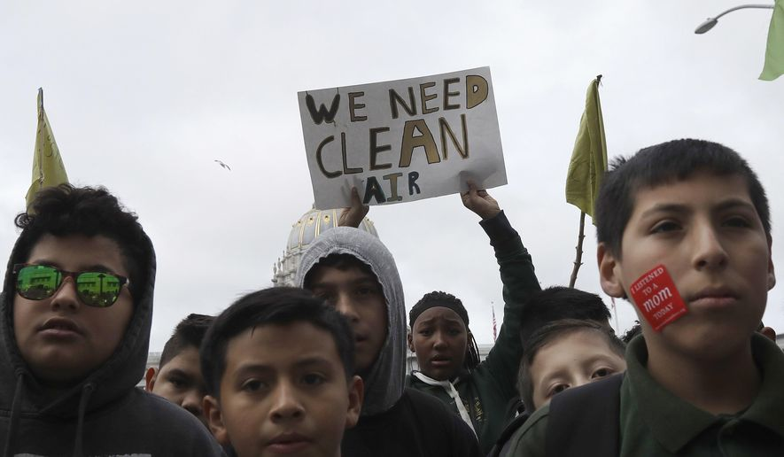 """Students listen to speakers at a rally for clean energy in San Francisco, Wednesday, Feb. 28, 2018. California stands in """"complete opposition"""" to a Trump administration plan to scrap a policy slashing climate-changing emissions from power plants, its top air official said Wednesday at a U.S. hearing in a state helping lead the fight against global warming. (AP Photo/Jeff Chiu) **FILE**"""