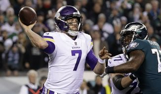 FILE - In this Sunday, Jan. 21, 2018 file photo, Minnesota Vikings quarterback Case Keenum throws during the first half of the NFL football NFC championship game against the Philadelphia Eagles in Philadelphia. The Minnesota Vikings have three quarterbacks about to become free agents, with question marks surrounding each of them. With Kirk Cousins about to hit the market, too, they could decide to go even bigger. (AP Photo/Matt Slocum, File)