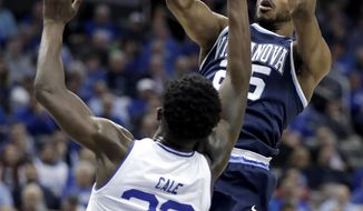 Villanova guard Mikal Bridges (25) shoots against Seton Hall guard Myles Cale (22) during the first half of an NCAA college basketball game, Wednesday, Feb. 28, 2018, in Newark, N.J. (AP Photo/Julio Cortez)