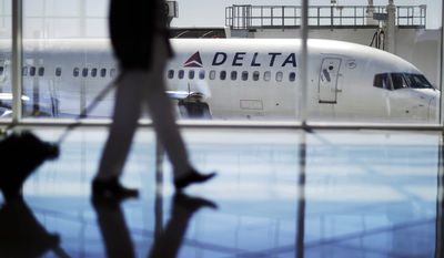 FILE - In this Oct. 13, 2016, file photo, a Delta Air Lines jet sits at a gate at Hartsfield-Jackson Atlanta International Airport in Atlanta. Delta Air Lines, Inc. reports earnings, Wednesday, Oct. 11, 2017. (AP Photo/David Goldman, File)
