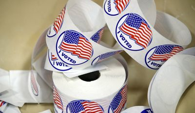"File photo of ""I Voted,"" stickers as seen at a polling place Tuesday, Nov. 7, 2017, in Alexandria, Va.  (AP Photo/Alex Brandon) **FILE**"