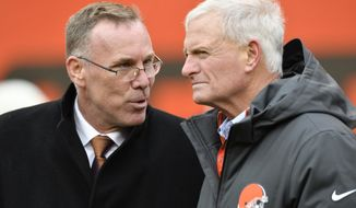 Cleveland Browns general manager John Dorsey, left, talks with owner Jimmy Haslam before an NFL football game against the Green Bay Packers, Sunday, Dec. 10, 2017, in Cleveland. The Packers won 27-21 in overtime. (AP Photo/David Richard)