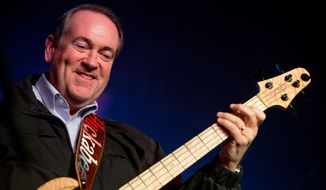 Republican presidential candidate former Arkansas Gov. Mike Huckabee plays bass guitar as he performs with the 80's rock band FireHouse at the Surf Ballroom in Clear Lake, Iowa, Friday, Jan. 22, 2016. In 2008, Huckabee performed at the ballroom, made famous for being the last venue Buddy Holly played before dying in a plane crash in 1959. (AP Photo/Andrew Harnik)