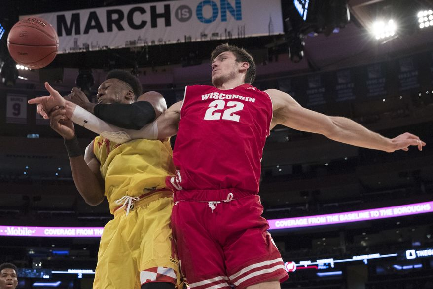 Wisconsin forward Ethan Happ (22) and Maryland forward Bruno Fernando fight for a rebound during the first half of an NCAA college basketball game in the second round of the Big Ten conference tournament, Thursday, March 1, 2018, at Madison Square Garden in New York. (AP Photo/Mary Altaffer)