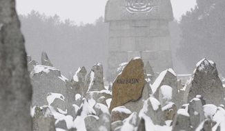 This Friday, Feb. 18, 2011, file photo, shows the Memorial on the grounds of the former German Nazi Death Camp Treblinka, near the village of Treblinka, northeast Poland. A Polish law that criminalizes accusing the Polish nation of crimes that were committed by Nazi Germany has taken effect, Thursday March 1, 2019. The law has sparked a crisis with Israel, where officials fear its true aim is to repress research on Poles who killed Jews during World War II, something Polish officials deny. (AP Photo/Alik Keplicz, File)