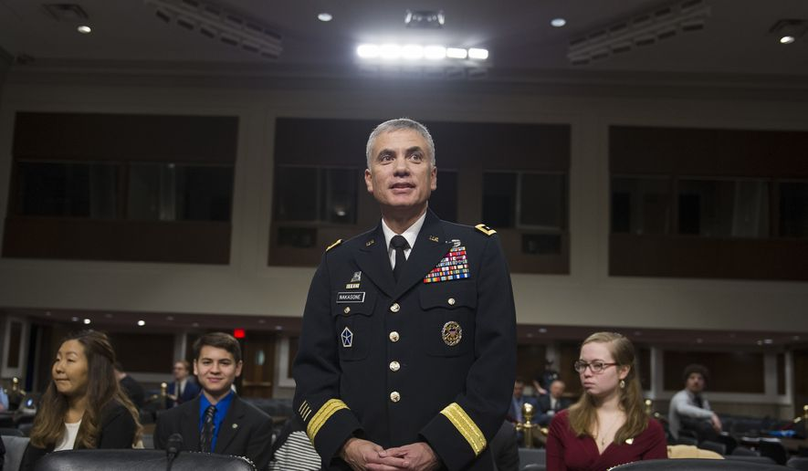 Army Lt. Gen. Paul Nakasone appears before the Senate Armed Services Committee to discuss his qualifications as nominee to be National Security Agency Director and U.S. Cyber Command Commander, during a hearing on Capitol Hill in Washington, Thursday, March 1, 2018. (AP Photo/Cliff Owen)