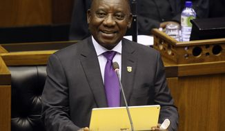 "South Africa's new President, Cyril Ramaphosa, delivers his State of the Nation address in parliament in Cape Town, South Africa. Ramaphosa says the transfer of some land from the country's white minority to the black majority will be handled without damaging the economy and that there will be ""no smash and grab"". South Africa seeks to address the legacy of apartheid more than two decades after the end of white rule. Ramaphosa said Thursday, March 1 that the transfer will be handled through dialogue. (AP Photo/Ruvan Boshoff, File)"