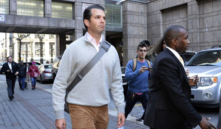 In this Wednesday, Feb. 28, 2018 photo, Donald Trump Jr. leaves Manhattan Supreme Court during a lunch break when he was summoned for jury duty, in New York. The New York Daily News says Trump was among the prospective jurors for an attempted robbery case, but didn't get picked to serve. (Jefferson Siegel/The Daily News via AP)