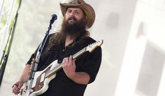 "FILE - In this July 18, 2017, file photo, Chris Stapleton performs on NBC's ""Today"" show at Rockefeller Plaza in New York. Stapleton leads the Academy of Country Music Awards with eight nominations, including entertainer of the year, announced Thursday, March 1, 2018. (Photo by Charles Sykes/Invision/AP, File)"