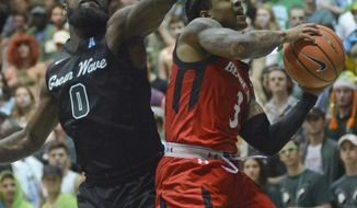 Cincinnati guard Justin Jenifer, right, drives the ball against Tulane guard Jordan Cornish, left, in the first half of an NCAA college basketball game in New Orleans, La., on Thursday, March 1, 2018. (AP Photo/Veronica Dominach)