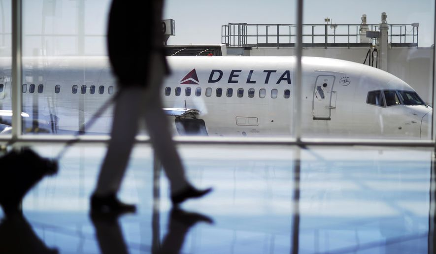 In this Oct. 13, 2016, file photo, a Delta Air Lines jet sits at a gate at Hartsfield-Jackson Atlanta International Airport in Atlanta. Georgia lawmakers punished Atlanta-based Delta Air Lines on Thursday, March 1, 2018, for its decision to cut business ties with the National Rifle Association in the wake of a shooting at a Florida high school that killed over a dozen people. A tax measure, which was stripped of a jet-fuel tax break, passed the GOP-dominated Senate 44-10. (AP Photo/David Goldman, File)