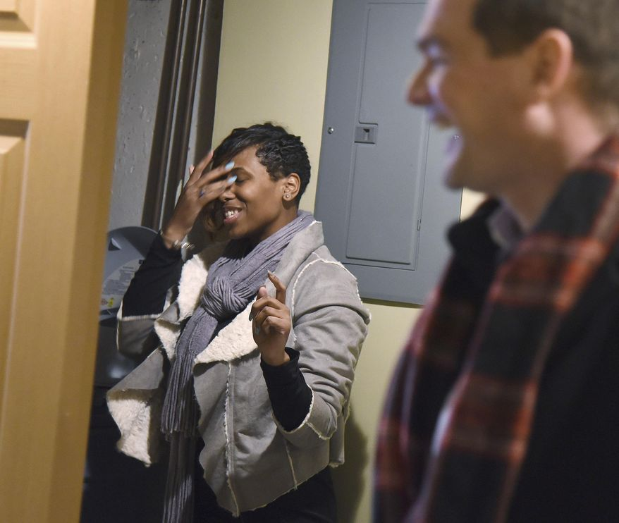 In this Feb. 6, 2018 photo, U.S. Navy Seaman Shynae Murphy is a little overwhelmed as she  tours her finished basement on her first visit to her newly renovated, mortgage-free home in Algonquin, Ill. She was awarded the house through Homes on the Homefront, an Operation Homefront program that provides military families with mortgage-free residences and homeowner counseling. The houses are renovated and donated by corporate partners, in this case, JPMorgan Chase. (Rick West/Daily Herald, via AP)
