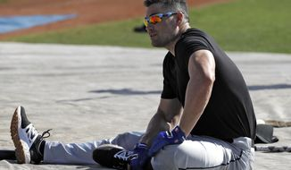 Major League Baseball free agent Luke Scott stretches before taking his turn in the batting cage Thursday, March 1, 2018, in Bradenton, Fla. (AP Photo/Chris O'Meara)