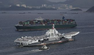 In this July 7, 2017, file photo, the Liaoning, China's first aircraft carrier, sails into Hong Kong for a port call. Chinese media reports say the country is planning to build a nuclear-powered aircraft carrier capable of remaining at sea for long durations, in what would mark a major upgrade for its increasingly formidable navy. (AP Photo/Kin Cheung, File)