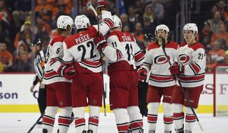 From left to right, Carolina Hurricanes' Noah Hanifin, Brett Pesce, Jordan Staal, Justin Williams and Brock McGinn celebrate after Williams scored a goal during the second period of an NHL hockey game against the Philadelphia Flyers, Thursday, March 1, 2018, in Philadelphia. (AP Photo/Derik Hamilton)