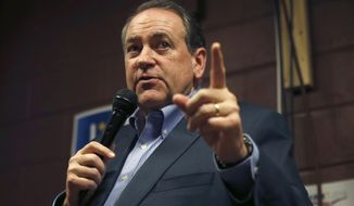 In this Jan. 31, 2016, photo, former Republican presidential candidate and former Arkansas Gov. Mike Huckabee speaks at Inspired Grounds Cafe in West Des Moines, Iowa. (AP Photo/Kiichiro Sato, File)