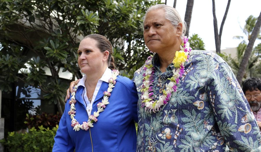 FILE - In this Oct. 20, 2017 file photo, former Honolulu Police Chief Louis Kealoha, right, and his wife, Katherine leave federal court in Honolulu. A foreclosure lawsuit alleges that the former Honolulu police chief and his deputy prosecutor wife aren't paying their home mortgage. The lawsuit filed by Hawaii Central Federal Credit Union comes as Louis and Katherine Kealoha fight a criminal indictment for corruption. The credit union claims the couple have defaulted on a $1 million mortgage. (AP Photo/Caleb Jones, File)