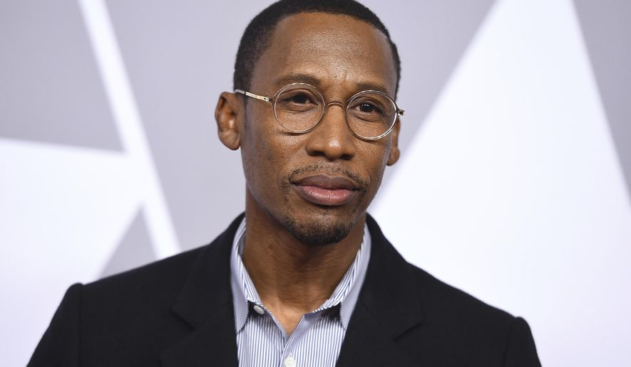 """FILE - In this Feb. 5, 2018 file photo, Raphael Saadiq arrives at the 90th Academy Awards nominees luncheon in Beverly Hills, Calif. Saadiq along with Taura Stinton and Mary J. Blige are nominated for an Oscar for original song for """"Mighty River,"""" from the film """"Mudbound."""" (Photo by Jordan Strauss/Invision/AP, File)"""