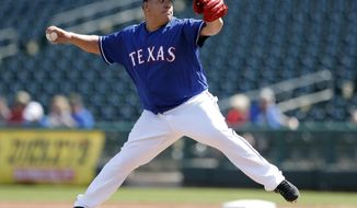 Texas Rangers starting pitcher Bartolo Colon throws during the first inning of a spring training baseball game against the San Diego Padres, Thursday, March 1, 2018, in Surprise, Ariz. (AP Photo/Charlie Neibergall)