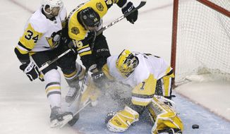 Boston Bruins center David Krejci (46) scores against Pittsburgh Penguins goaltender Casey DeSmith (1) as Penguins right wing Tom Kuhnhackl (34) defends during the first period of an NHL hockey game Thursday, March 1, 2018, in Boston. (AP Photo/Elise Amendola)