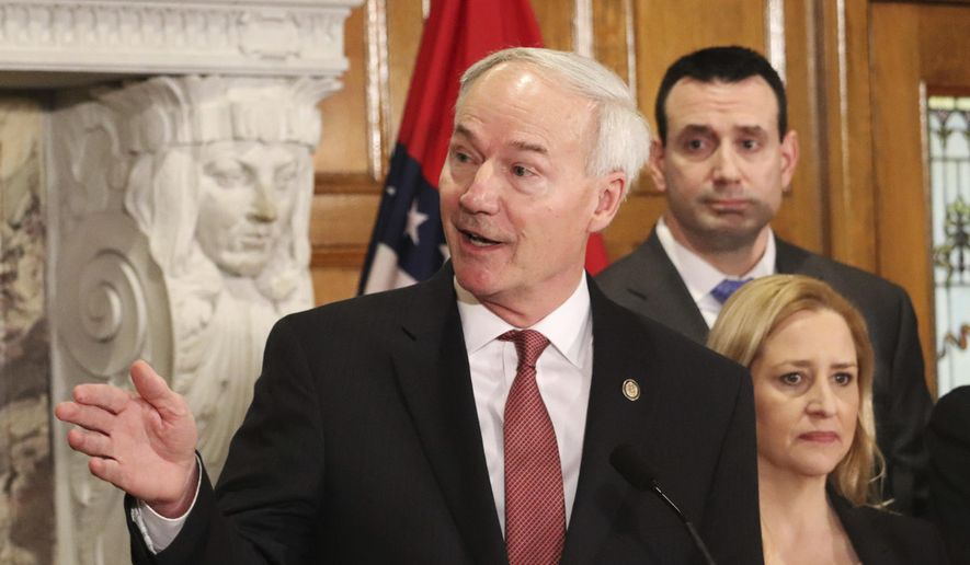 Gov. Asa Hutchinson speaks during a news conference announcing the establishment of a committee to study school safety issues Thursday, March 1, 2018, in Little Rock, Ark. Hutchinson named school officials and people with law enforcement backgrounds to the panel in response to last month's school shooting in Florida.(AP Photo/Kelly Kissel)