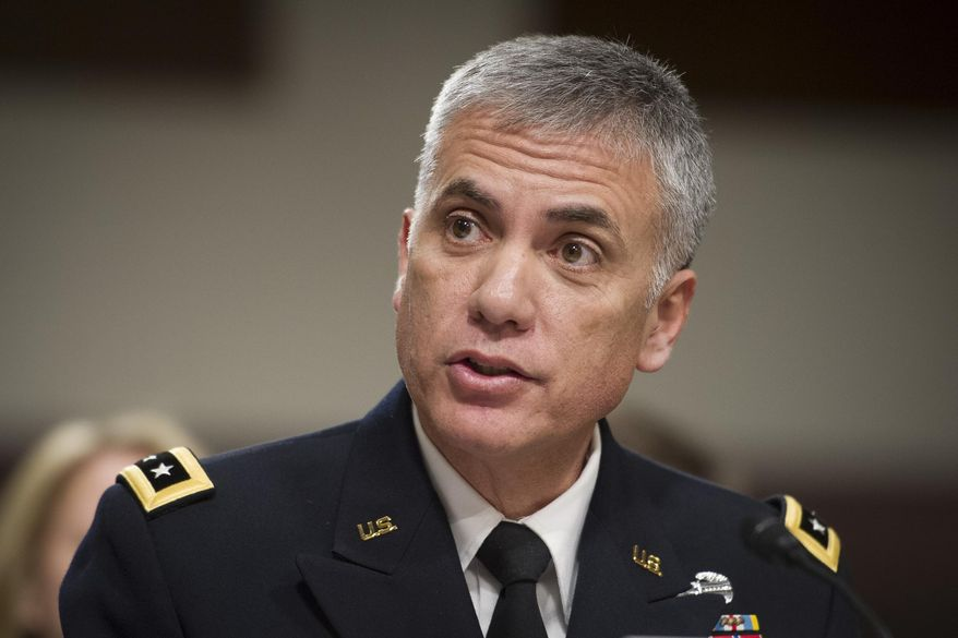 Army Lieutenant General Paul Nakasone appears before the Senate Armed Services Committee to discuss his qualifications as nominee to be National Security Agency Director and U.S. Cyber Command Commander, during a hearing on Capitol Hill in Washington, Thursday, March 1, 2018. (AP Photo/Cliff Owen)