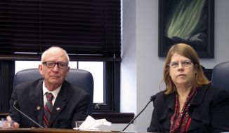Alaska state Rep. Tammie Wilson, right, sits next to State Rep. Steve Thompson during a House minority news conference on Thursday, March 1, 2018, in Juneau, Alaska. Wilson says she has taken required training to prevent harassment and discrimination after being assured that an updated legislative policy addressing sexual and other harassment would be vetted by a third-party. (AP Photo/Becky Bohrer)